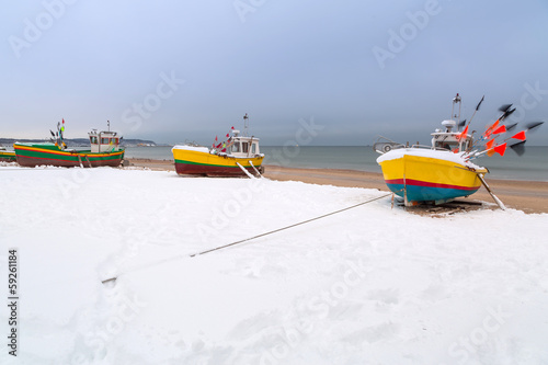 Winter scenery of fishing boats at Baltic Sea in Poland