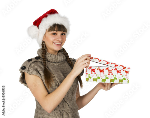 Smiling girl in red santa caps and gift in a hands on a white