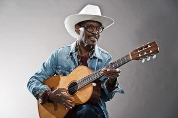 Retro senior afro american blues man in times of slavery. Wearin