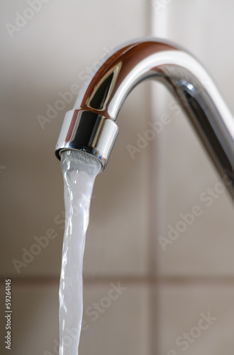 Tap with Water Flowing