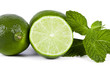 limes with mint leaves on white background