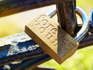 Forever young inscription on a padlock