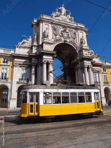 Typical tram in Commerce Square, Lisbon, Portugal.