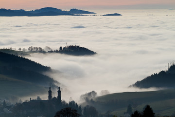 St. Peter in black forest, Germany, above clouds