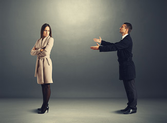 man apologizing to offended woman
