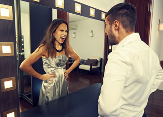 man shouting at mad woman in the mirror