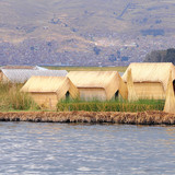 Uros islands with small houses. Titicaca lake.