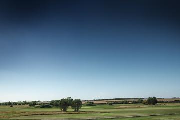 Bright blue sky over field