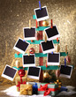 Wooden hand made fir tree with empty photo paper and Christmas