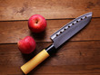 Kitchen knife and  apple,  on wooden background