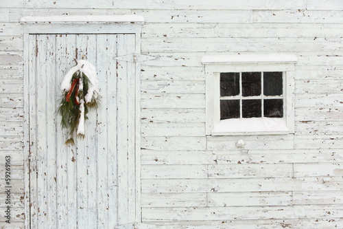 Old Door and Window with White Peeling Paint and Wreath