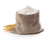 Flour in bag with wheat ears isolated on white background