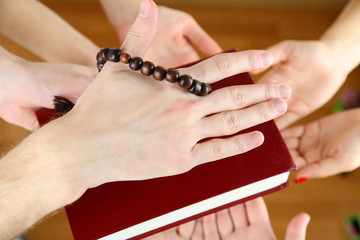 Muslim praying hands on light background