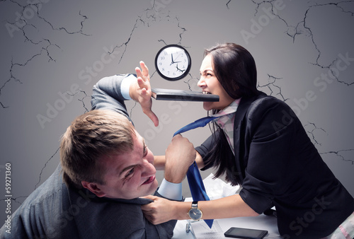 Two young caucasian office worker starting to fight