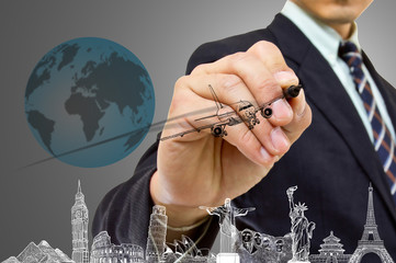 Businessman hand write Travel concept