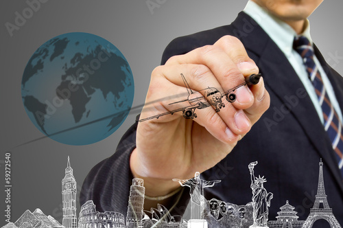 Businessman hand write Travel concept