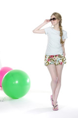 pretty leisure woman with slim pose with ball walking in studio