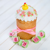 Easter cake decorated with a hen and roses, studio shot