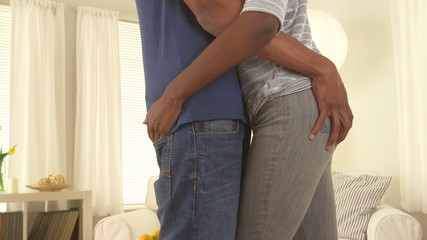 Black couple holding one another's waists