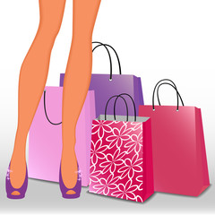 Women's legs and shopping bags