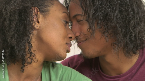 Black couple talking and being sweet