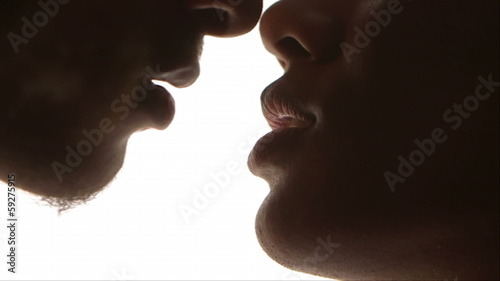 Close-up of black couple kissing
