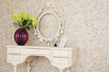 Wooden carved dressing table with blank frame and flowers