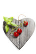 Fresh vegetables on heart shaped cutting board