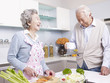 senior couple talking in kitchen