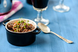 boeuf bourguignon classic french beef stew on blue table with a
