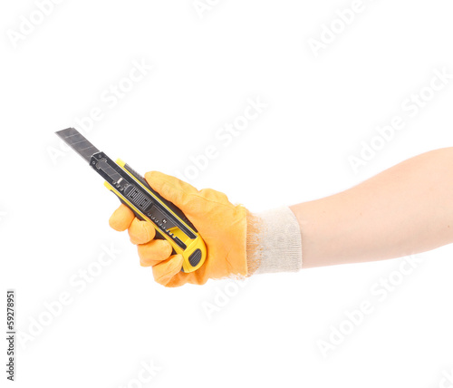 Hand in gloves holding knife.