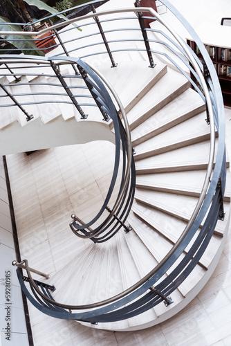 Foto op Plexiglas Trappen Sleek metal spiral staircase