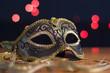 Leinwandbild Motiv Carnival mask on a background of holiday lights.