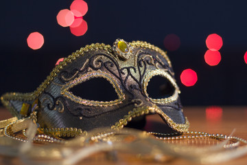Carnival mask on a background of holiday lights.