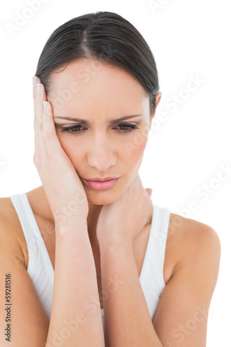 Close-up of a casual woman suffering from headache