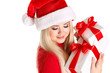 beautiful happy blond woman dressed as Santa holding a present i