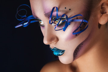 Horizontal photo of adult woman with creative make up in studio