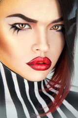Serious woman with sexy red lips looking at camera