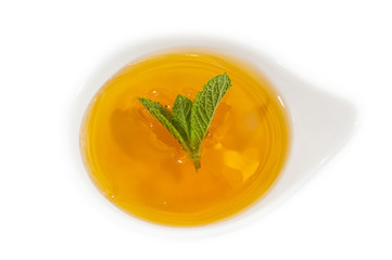 Dish decorated with mint and honey