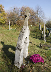 The old grave on rustic slovak cemetery on All Saints Day.