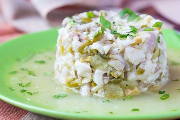 Tartar ceviche of raw white fish with olives, lemon, sauce