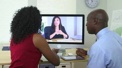 African American business team having a video conference
