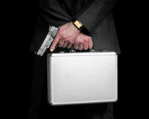 Businessman with gun and silver metal briefcase.