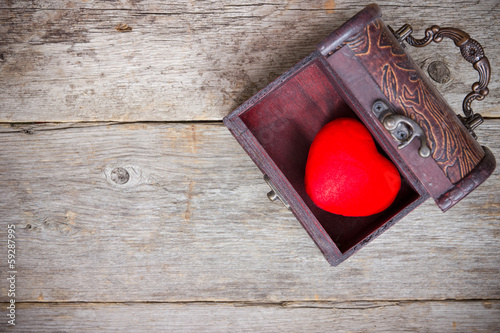 Red heart  in the old  box
