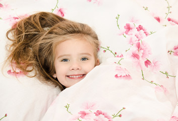 Adorable smiling little girl awaked up