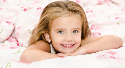 Adorable smiling little girl waked up
