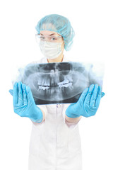 girl in white robe holds the x-ray picture in middle