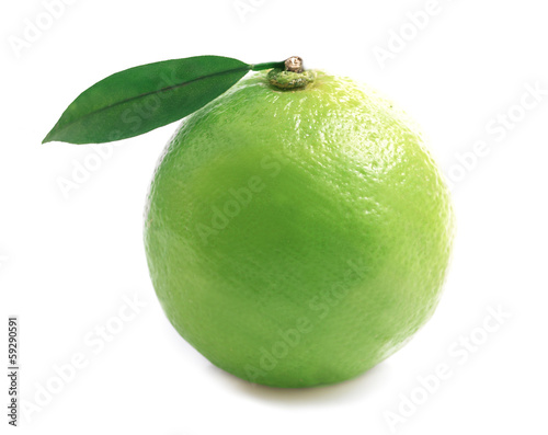 Ripe lime isolated on a white .