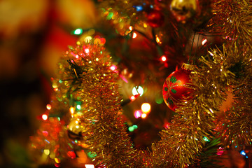 Christmas decorations with tinsel - warm colors