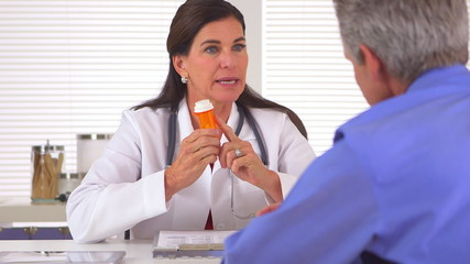 Doctor prescribing medication to elderly patient